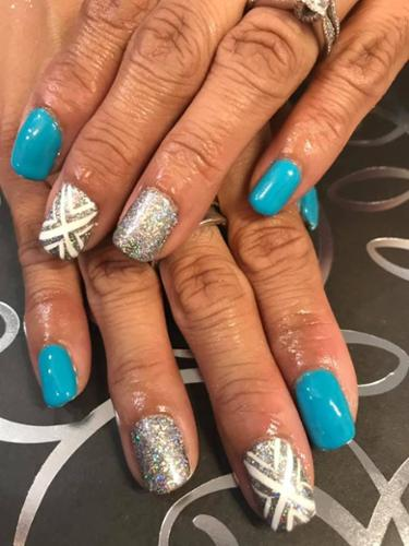Teal and silver SNS Dip Nails in our nail salon.